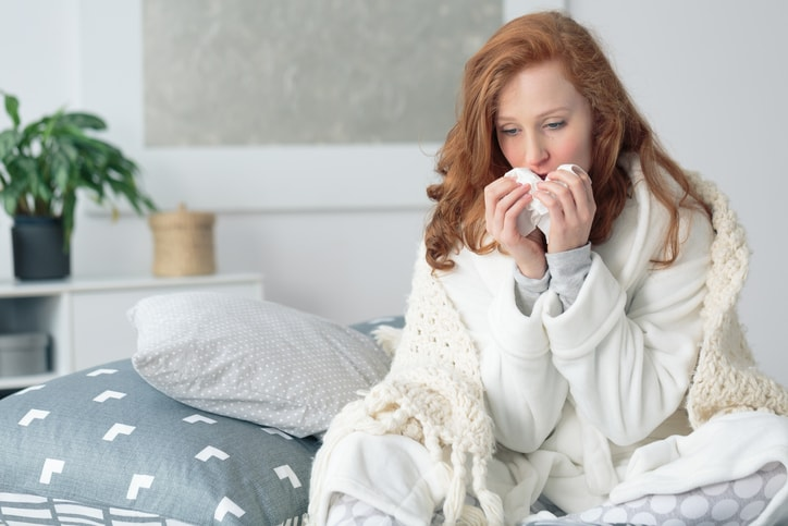 woman with a sinus infection in bed